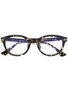جوتشي نظارات غوتشي مزينة بتفاصيل نظارات بإطار دائري